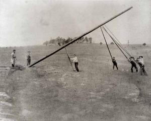 Historical Picture of Men Setting Up Pole